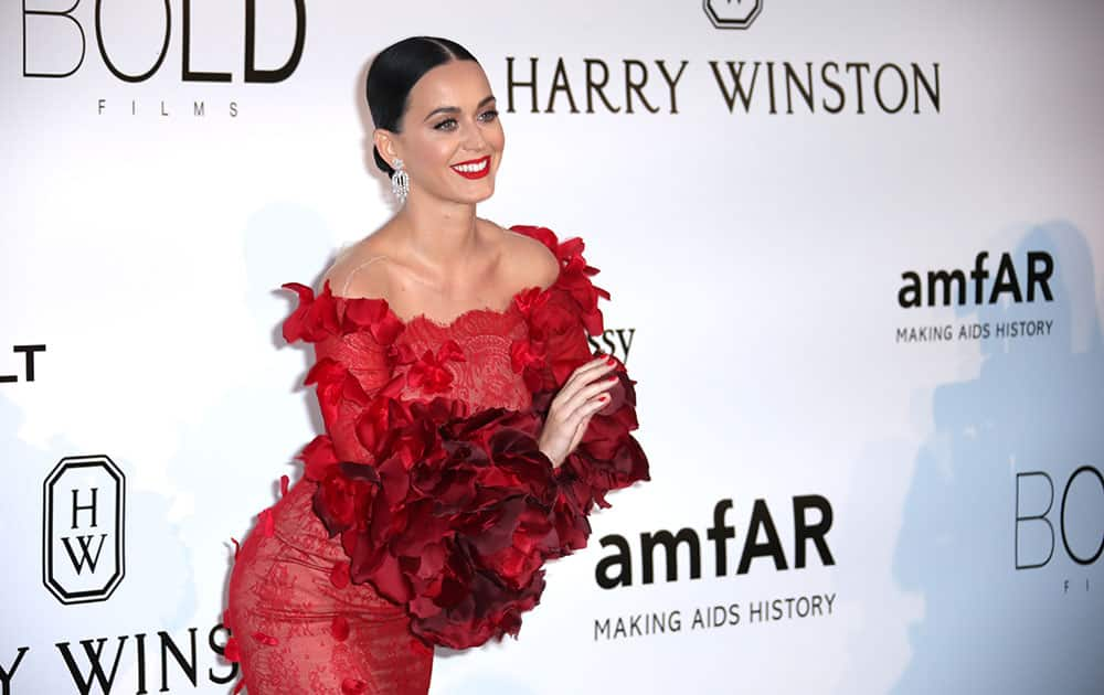 Singer Katy Perry poses for photographers upon arrival at the amfAR Cinema Against AIDS benefit at the Hotel du Cap-Eden-Roc, during the 69th Cannes international film festival, Cap d'Antibes, southern France.
