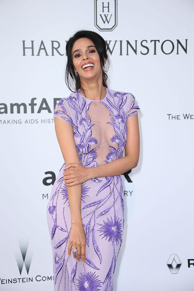 Actress Mallika Sherawat poses for photographers upon arrival at the amfAR Cinema Against AIDS benefit at the Hotel du Cap-Eden-Roc, during the 69th Cannes international film festival, Cap d'Antibes, southern France.