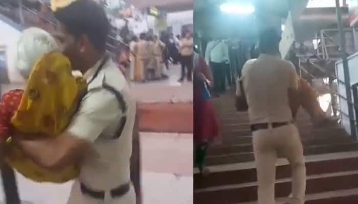 Act of humanity! Young cop lifts old woman in arms, helps her cross bridge during Simhasth Kumbh – Watch