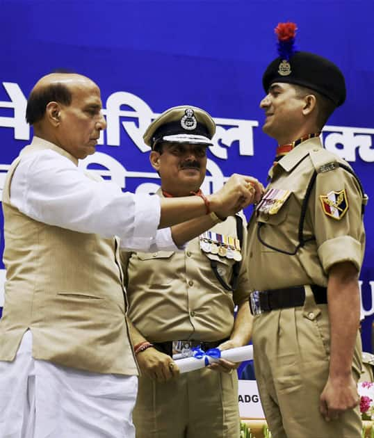 Union Home Minister Rajnath Singh presenting Police medal to a personnel during the 14th BSF Investiture ceremony, in New Delhi.