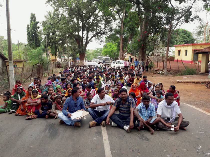 Villagers holding a protest on NH 30 against JNU professors who have been allegedly motivating local people to support Naxals, in Jagdalpur.