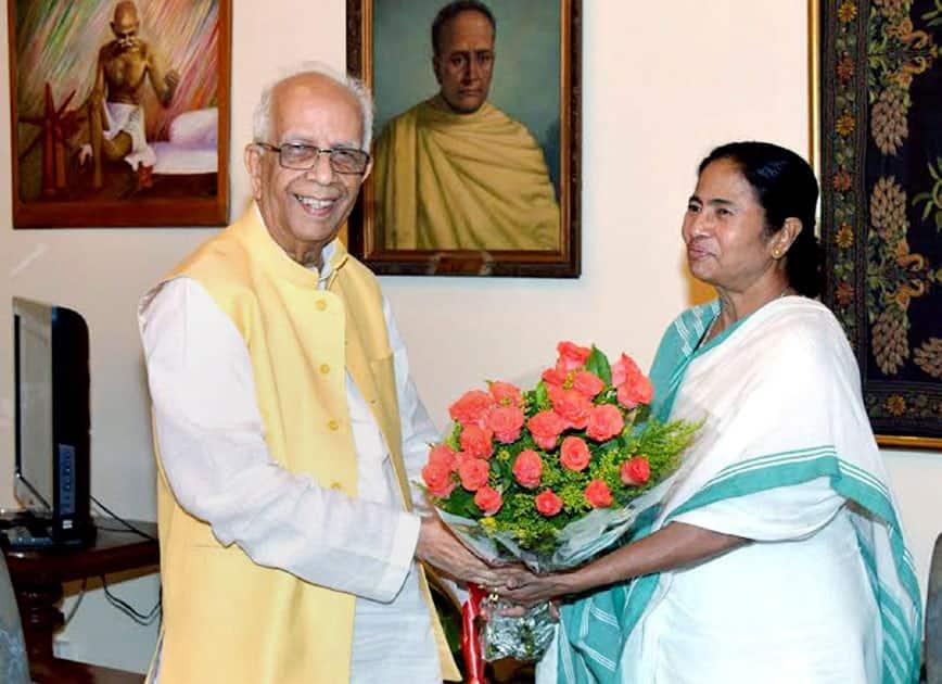 West Bengal Governor Keshari Nath Tripathy greeting TMC Supremo Mamata Banerjee during their meeting at Governors House in Kolkata.