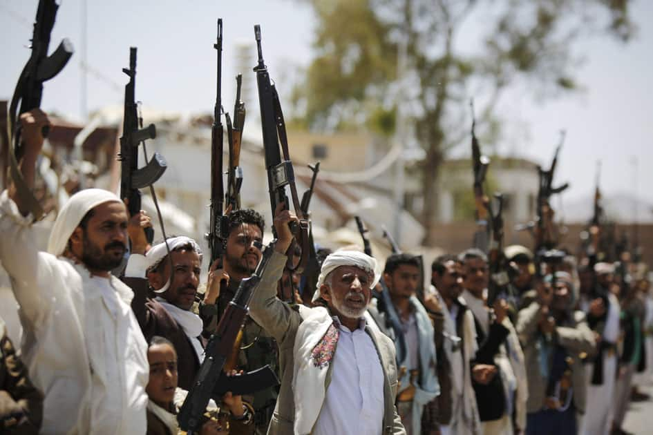 Shiite Houthi tribesmen hold their weapons as they chant slogans during a tribal gathering showing support for the Houthi movement, in Sanaa,Yemen.
