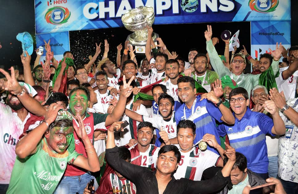 Players and officials of Mohan Bagan with winning trophy of Federation Cup 2016 after defeating Aizwal Football Club at Indira Gandhi Athletics Stadium, Sarusajai in Guwahati.
