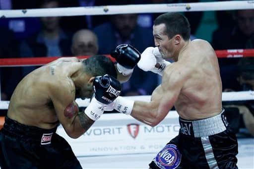 WBA cruiserweight world champion Denis Lebedev, right, punches IBF cruiserweight champion Victor Emilio Ramirez during their IBF and WBA Super World cruiserweight title fight in Moscow, Russia.