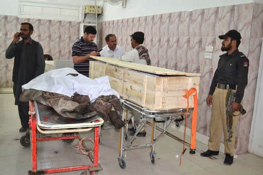 A Pakistani police officer and paramedics stand beside two dead bodies reportedly killed in a U.S. drone strike in the Ahmad Wal area in Baluchistan province, Pakistan, at a hopsital in Quetta, Pakistan.
