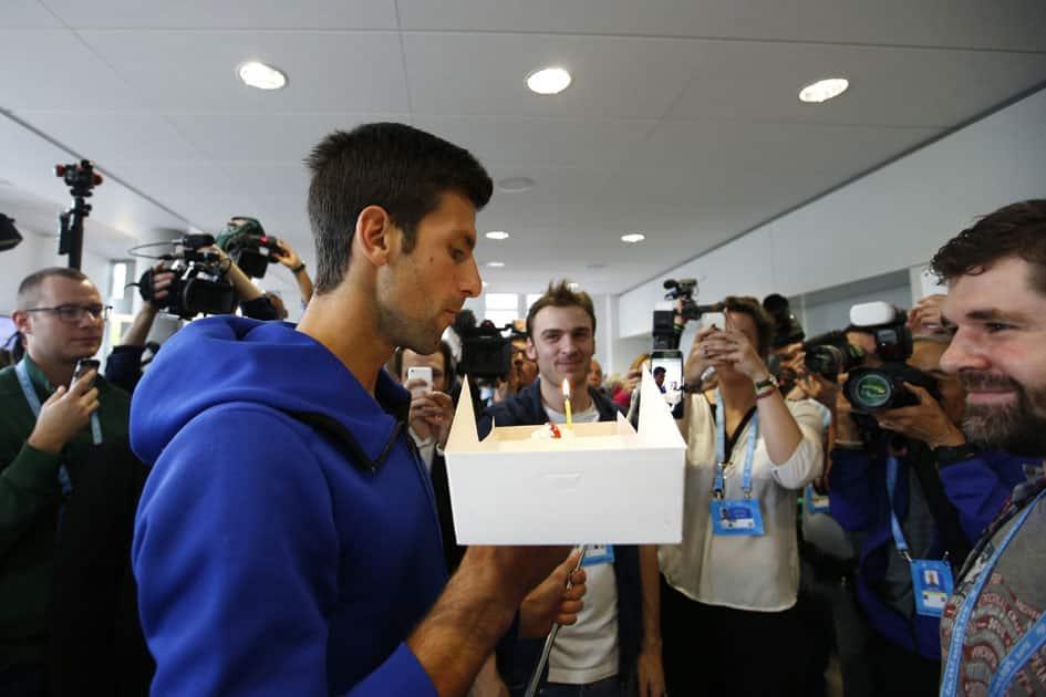 Paris : Serbias Novak Djokovic blows a candle on a birthday cake at the Roland Garros stadium.