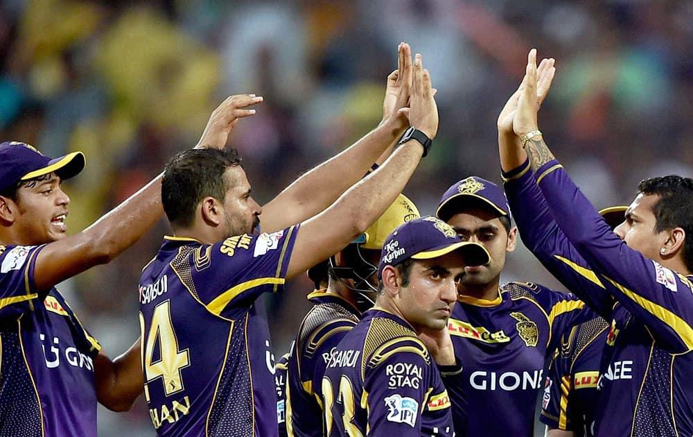 KKR bowler Sunil Naraine jubiliate with his teammates after dismissed SRH batsman David Warner during an IPL match against SRH in Kolkata.