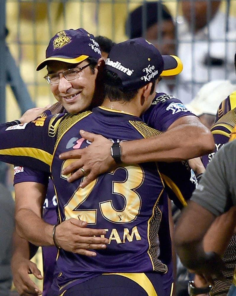 KKR captain Gautam Gambhir being greeted by his team bowling coach Wasim Akram after their win in IPL match against SRH in Kolkata.