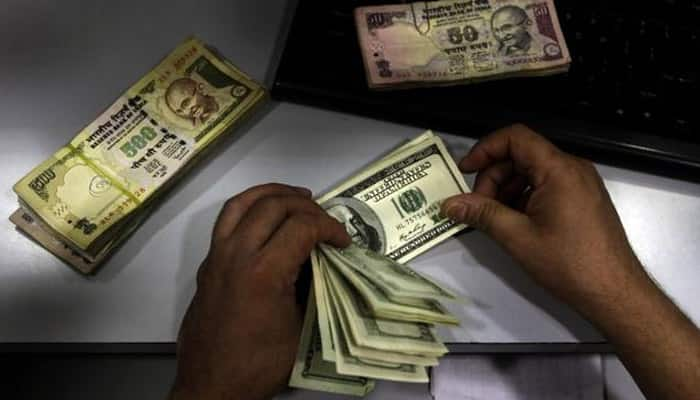 Rupee falls for eight straight session, holds at 2-1/2 month low of 67.49