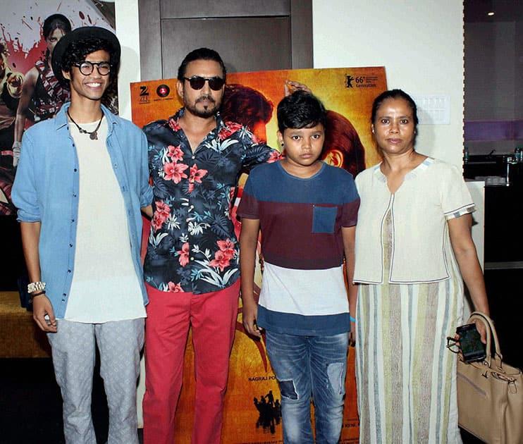 Irrfan Khan with his family during the special screening of Marathi film Sairat, in Mumbai.