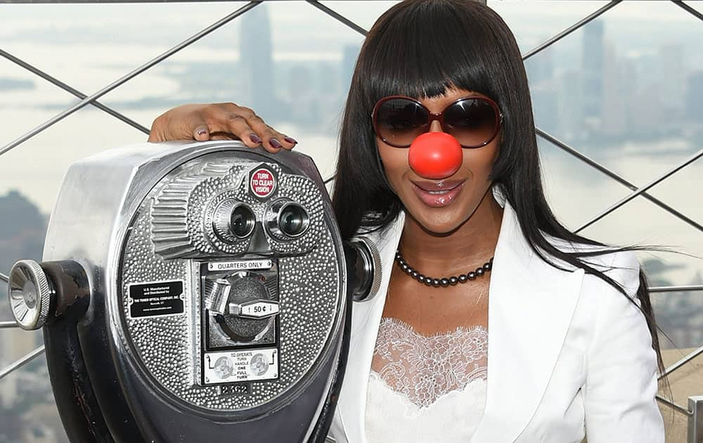 Model Naomi Campbell poses on the observatory of the Empire State Building in honor of Red Nose Day in New York.