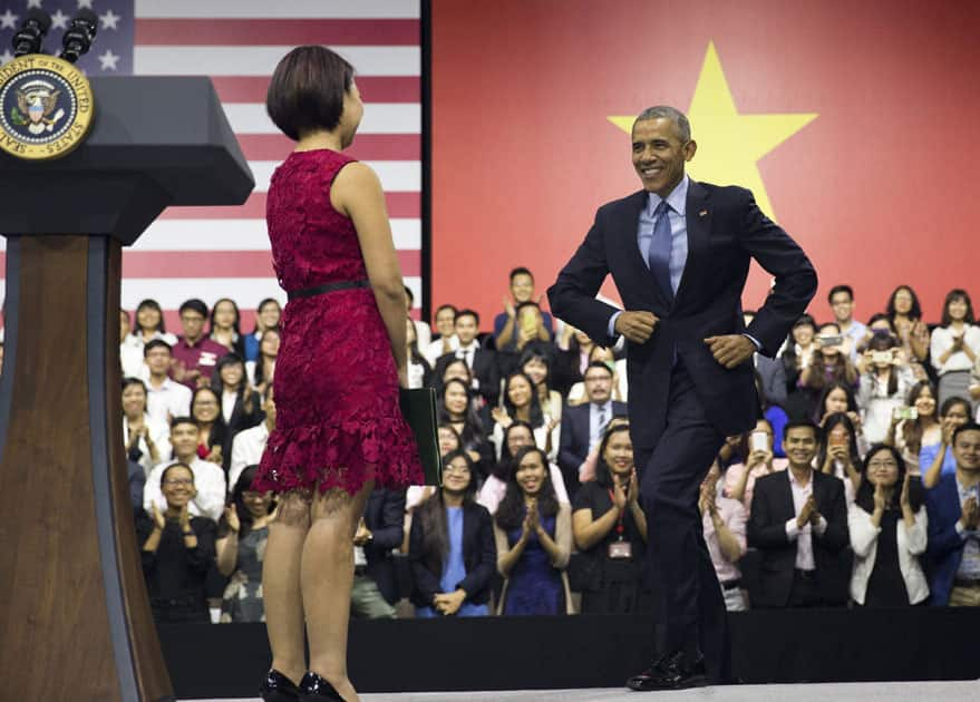 U.S. President Barack Obama is introduced by Tu Ngo, a member of the YSEALI (Young Southeast Asian Leaders Initiative) Network.