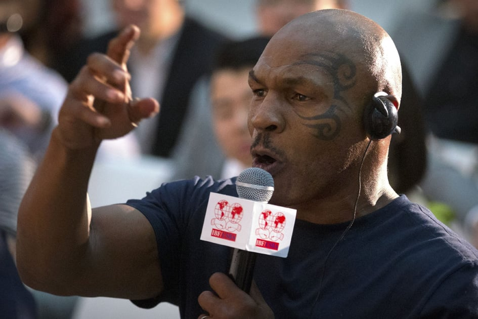 Former heavyweight boxing champion Mike Tyson speaks during a panel discussion held before the 2016 IBF World Championship Bout at the National Tennis Center in Beijing.