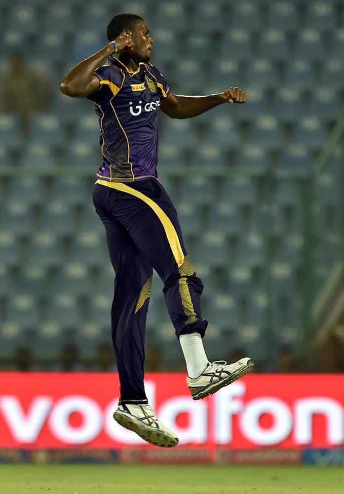 KKRs bowler Jason Holder celebrates the wicket of Sunrisers Hyderabad batsman Naman Ojha during the IPLT20 eliminator match at Feroz Shah Kotla in New Delhi.