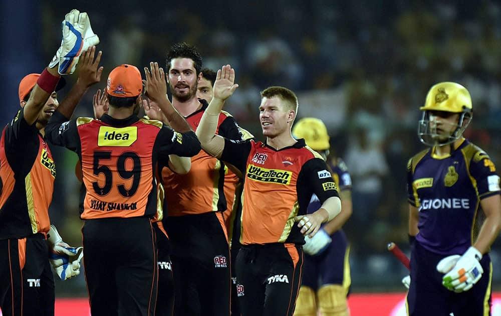 Sunrisers Hyderabad bowler Ben Cutting with team mates celebrate the wicket of KKRs batsman Gautam Gambhir during the IPLT20 eliminator match at Feroz Shah Kotla in New Delhi.