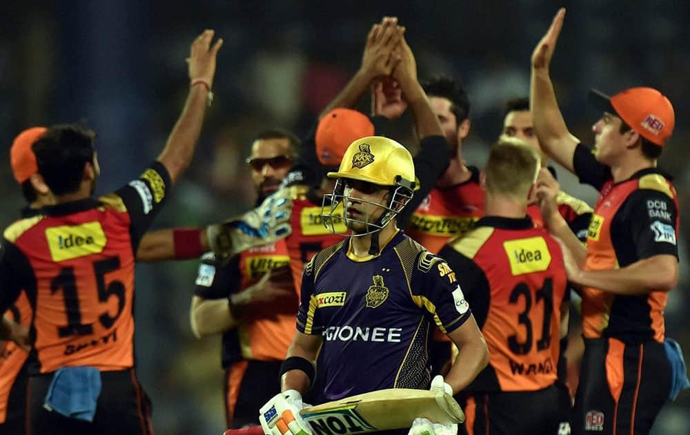KKRs batsman Gautam Gambhir returns after his dismissal as Sunrisers Hyderabad players celebrate during an eliminator match of the IPL T20 at Ferozshah Kotla in New Delhi.