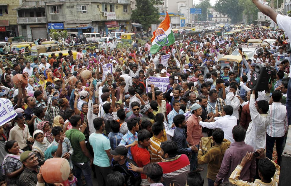 People carry earthen pitchers and shout anti BJP slogans during a protest against shortage of drinking water in Ahmedabad.