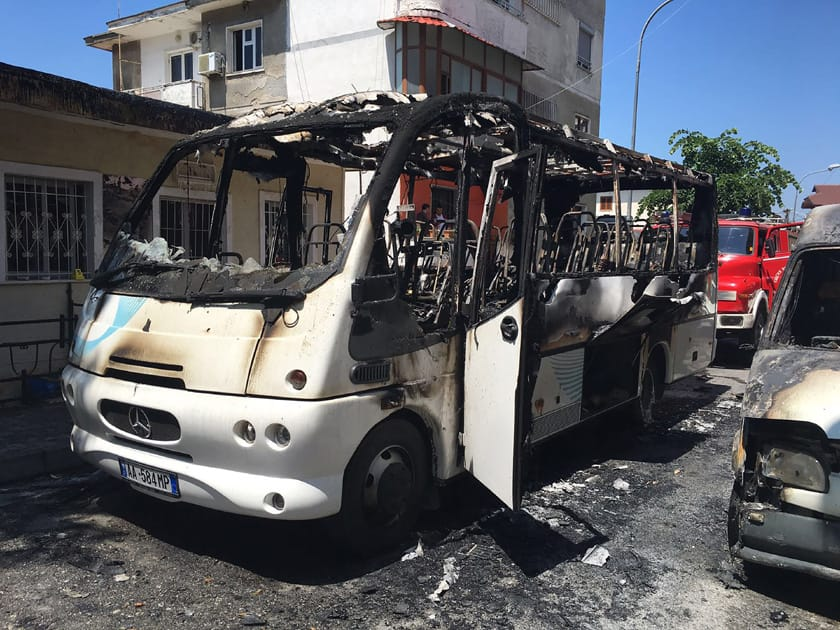 A burned bus is seen on the street in Kruja, 35 kilometers (22 miles) north of the capital, Tirana. Police say that one woman has died and 12 others were injured after a bus caught fire in northern Albania.