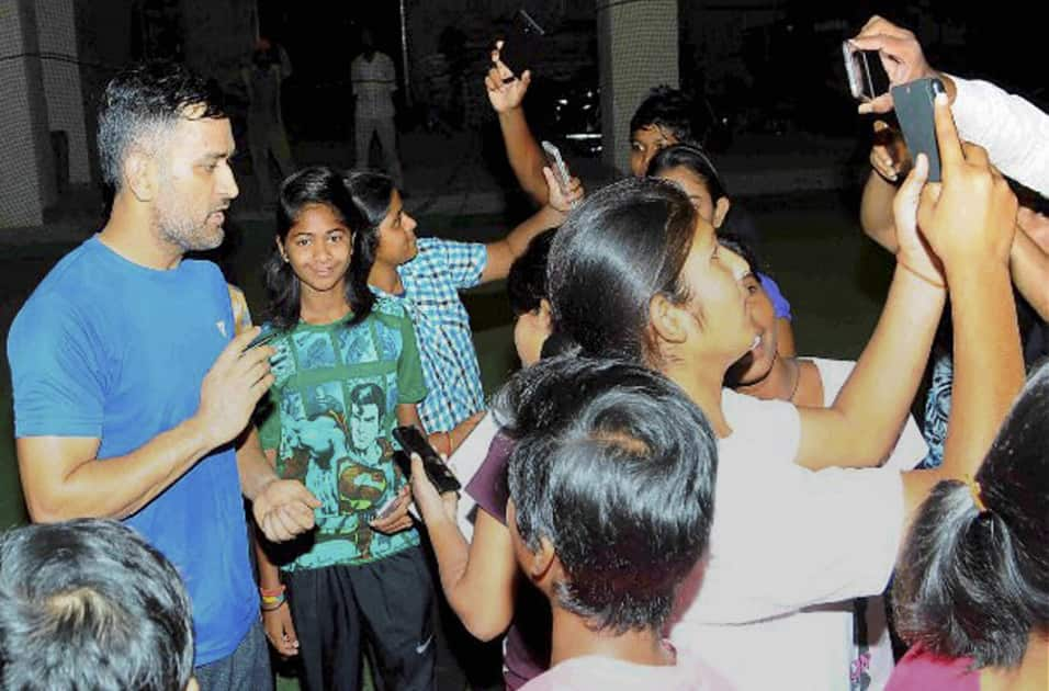 Indian cricket team skipper Mahendra Singh Dhoni poses for fans at Jharkhand state cricket association International Cricket stadium in Ranch.