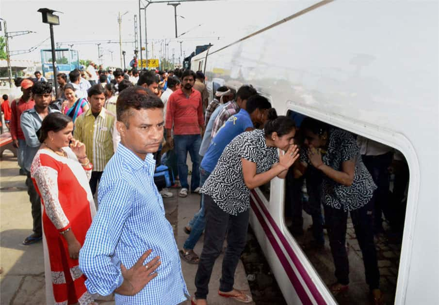 Passengers peep through the windows of the Spanish train Talgo at Bareilly Railway Station during its first trial run between Bareilly and Moradabd.
