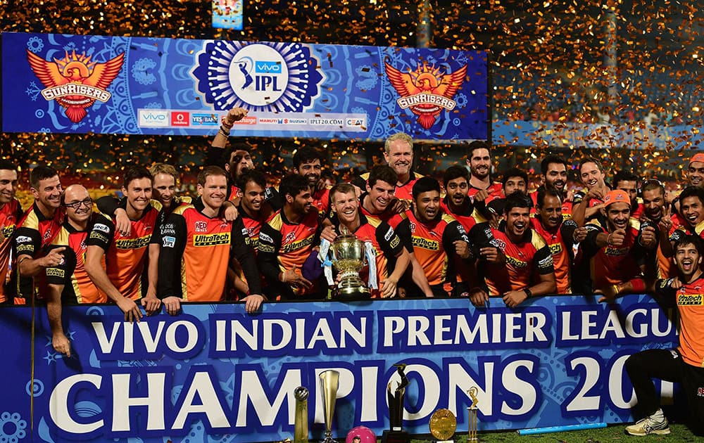 Sunrisers Hyderabad players celebrate with the winning trophy of IPL 2016 after beating Royal Challengers Bangalore in the final match at Chinnaswamy Stadium in Bengaluru.