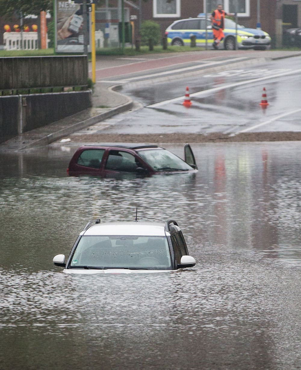 Cars got stuck in a flooded underpass in Oberhausen, Germany.