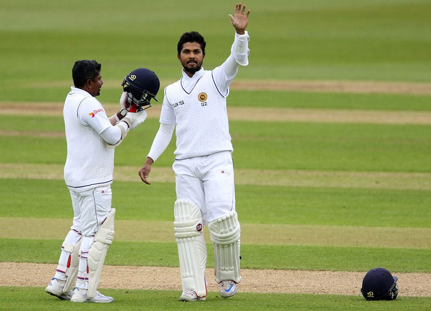 Sri Lanka's Dinesh Chandimal waves as he celebrates his 100 celebrates against England during day four of the second cricket Test match at the Emirates Riverside, Chester-Le-Street, England.