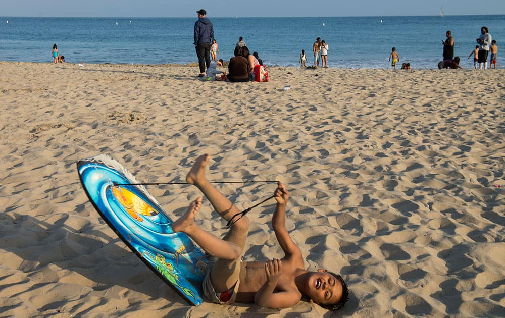 Gabriel Cordromp, 8, plays on the beach after beach goers were told over the loud speaker to get out of the water at Corona del Mar beach in Newport Beach, Calif.