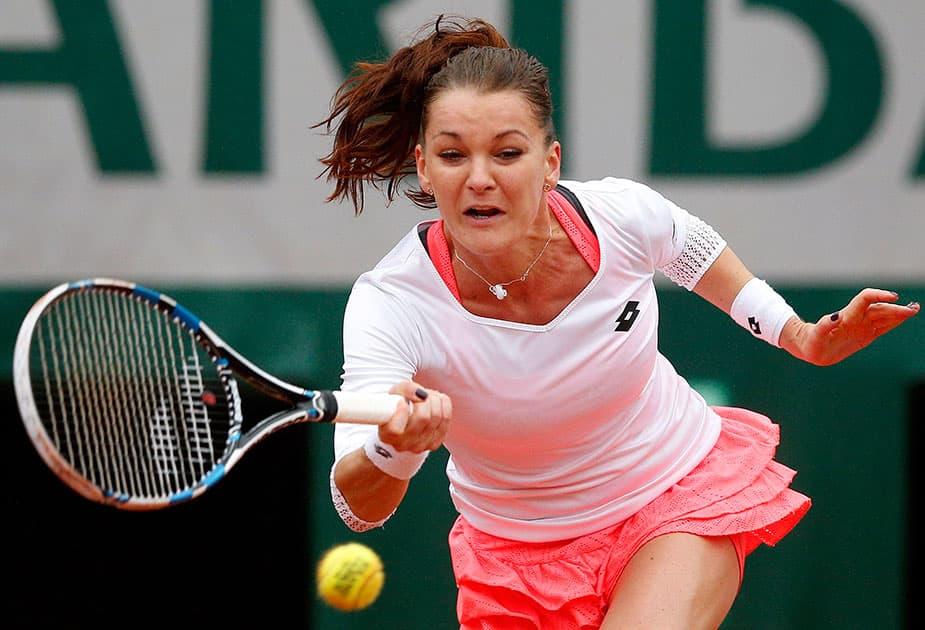 Poland's Agnieszka Radwanska returns the ball to Bulgaria's Tsvetana Pironkova during their fourth round match of the French Open tennis tournament at the Roland Garros stadium, in Paris.