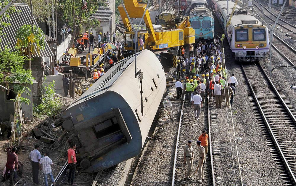 Restoration work in progress after an empty coach derailed off a slow track between Lower Parel and Elphinstone railway station in Mumbai.