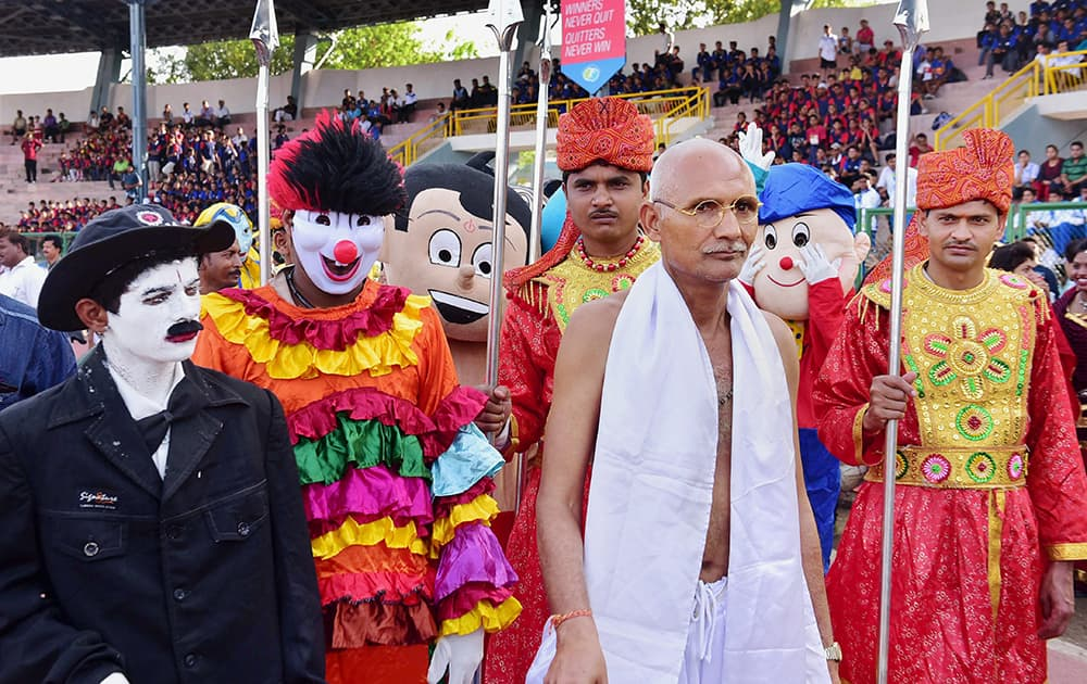 A man dressed as Gandhi accompanies a large number of youths in a Carnival Rally on the occasion of World No Tobacco Day.