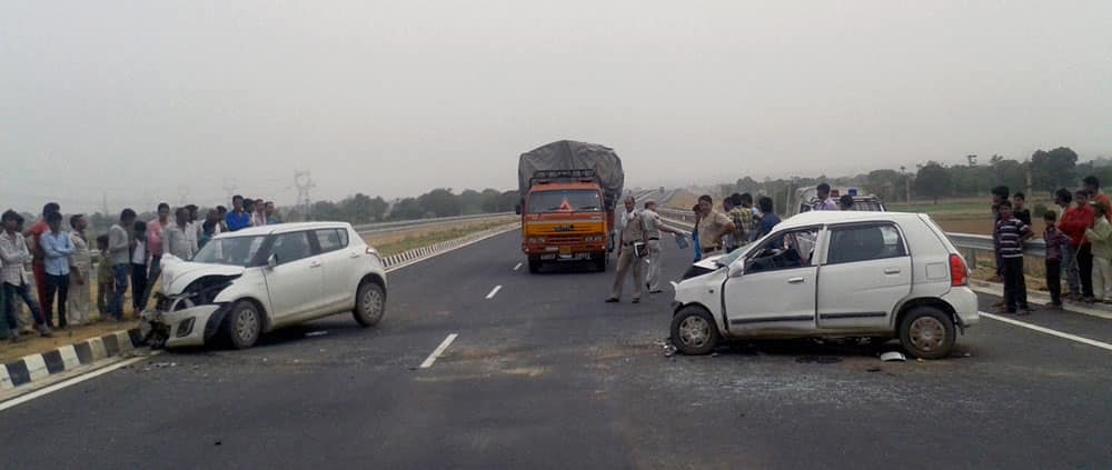 Damaged cars after an accident at newly opened KMP expressway near Tauru in Mewat.