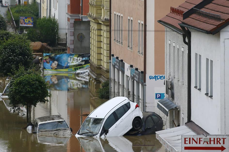 Cars float in the street in the flood waters in Simbach am Inn, Germany.