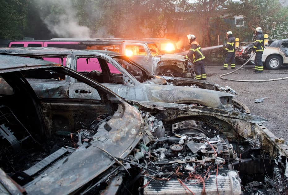 Firefighters extinguish burning cars in Hamburg, Germany.