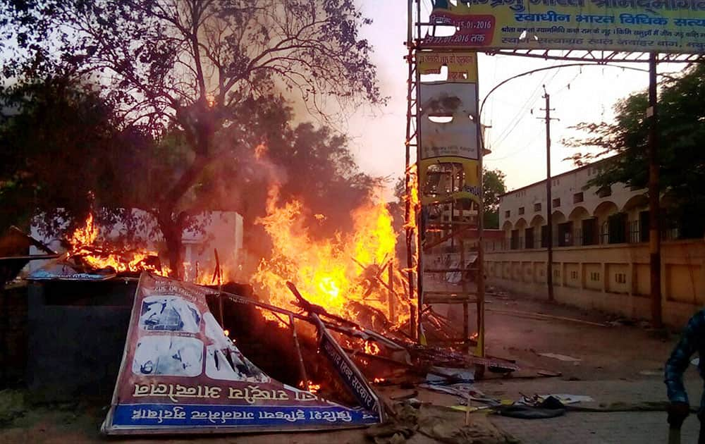 A fire break out after clashes between the police and the encroachers who were being evicted from Jawaharbagh in Mathura.