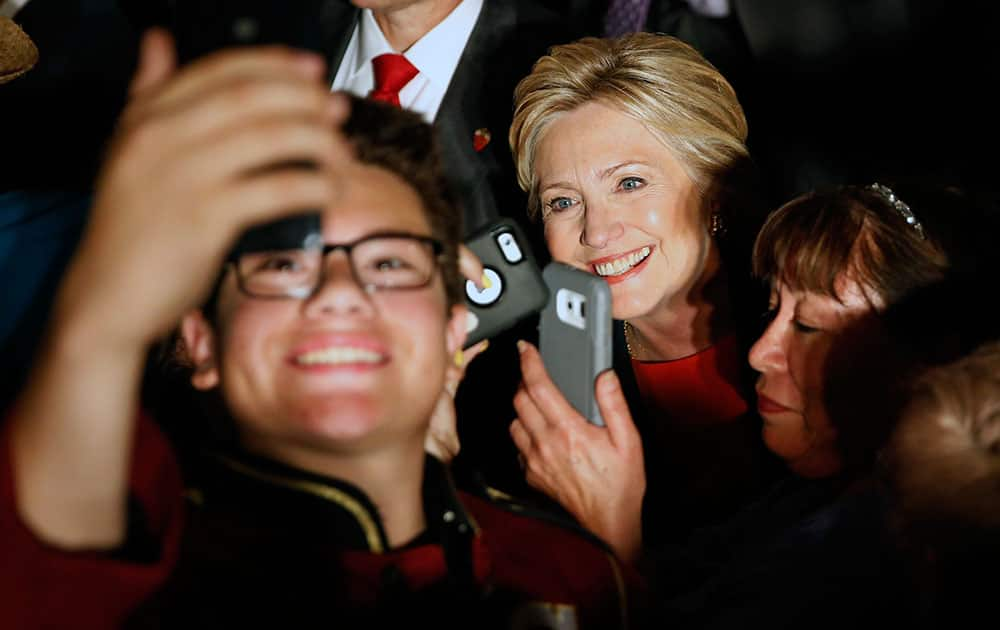 Democratic presidential candidate Hillary Clinton poses for photos at a rally, in El Centro, Calif.