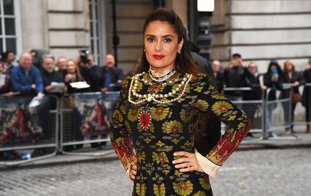 Actress Salma Hayek poses for photographers upon arrival at the premiere of the film 'Tale Of Tales' in London.