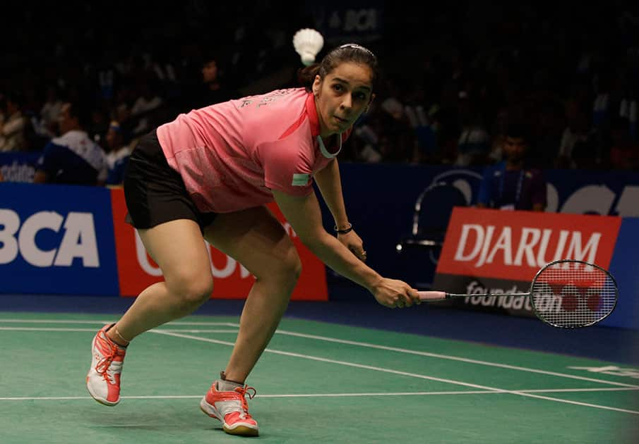 Saina Nehwal returns a shot to Spains Carolina Marin during their quaterfinal womens single match at the Indonesia Open badminton tournament at Istora Stadium in Jakarta.