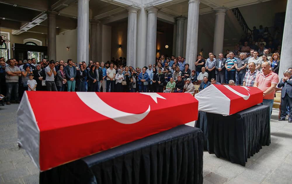 People attend a funeral ceremony at the Istanbul University