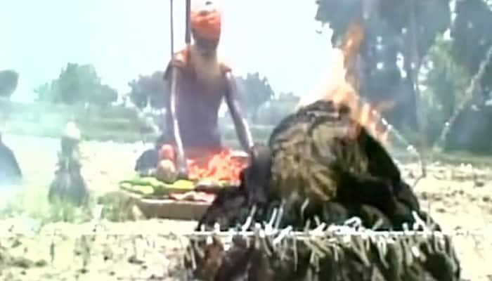 'Lord of the Rings' sadhu sits in the middle of 21 fire rings to appease rain gods