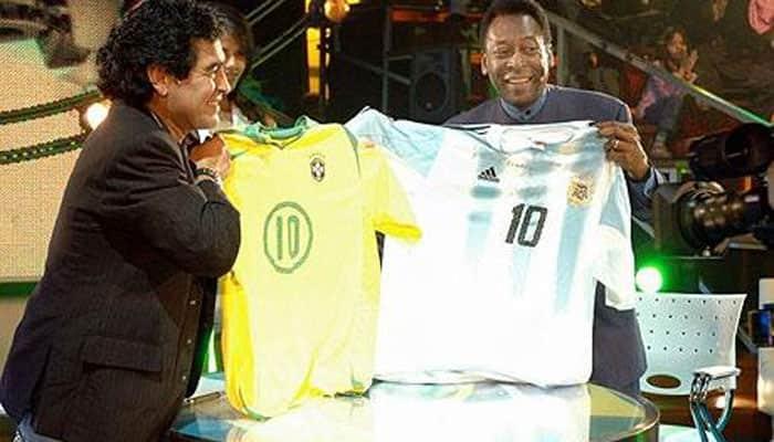 Old rivals Pele, Diego Maradona seek `peace`