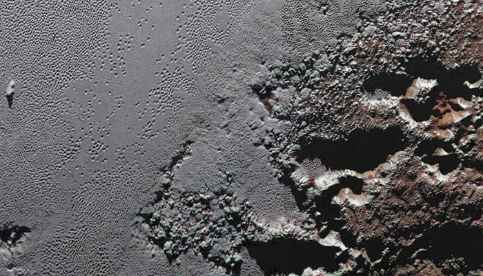 New view from NASA's New Horizons - The jagged shores of Pluto's highlands (Pic inside)
