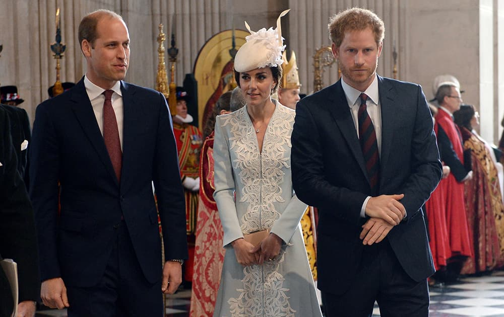Britain's Prince William, Kate, Duchess of Cambridge and Prince Harry