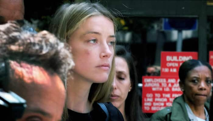 Is Amber Heard deliberately delaying deposition?
