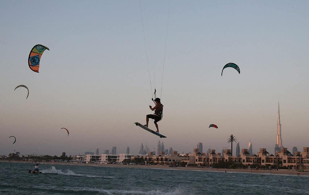 A man goes kite surfing at Kite Beach in Dubai