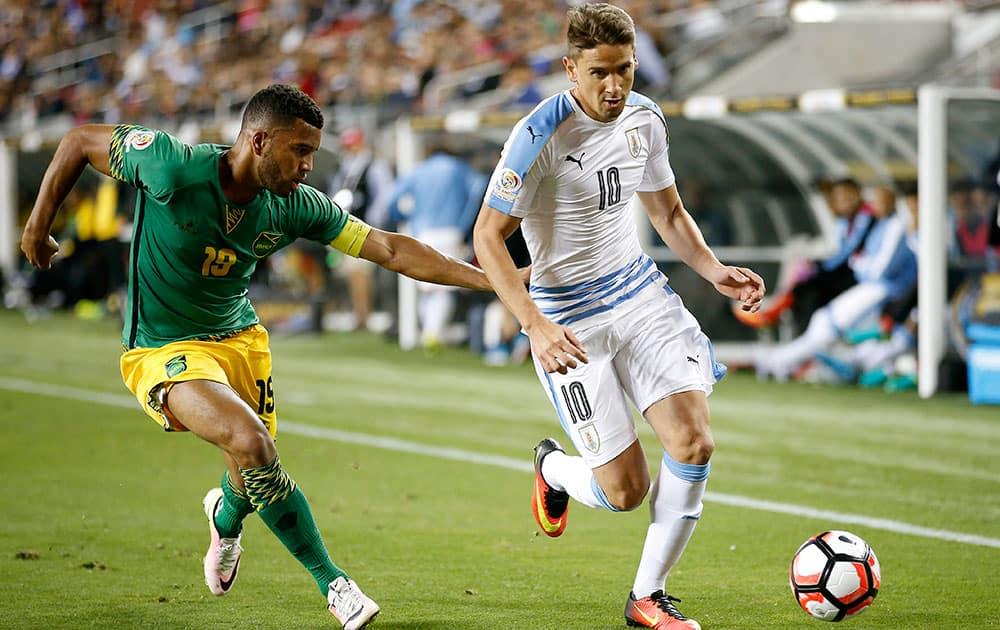 Uruguay's Gaston Ramirez (10) moves the ball past Jamaica's Adrian Mariappa