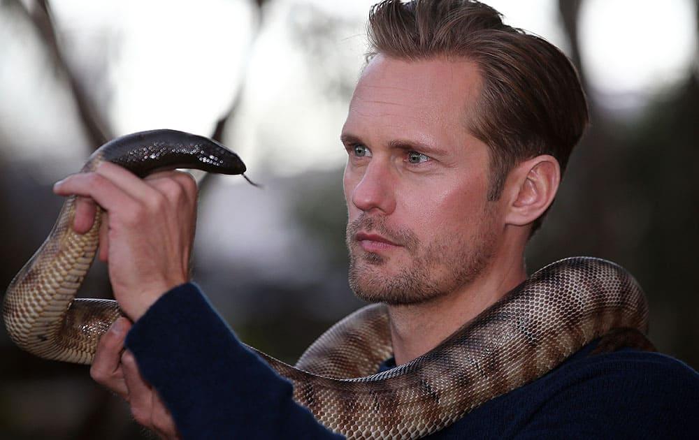 Actor Alexander Skarsgard with a python at Wildlife Sydney Zoo in Sydney