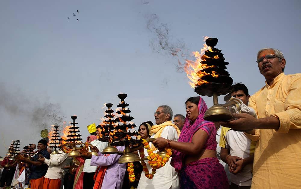 Hindu devotees offer prayers at Sangam