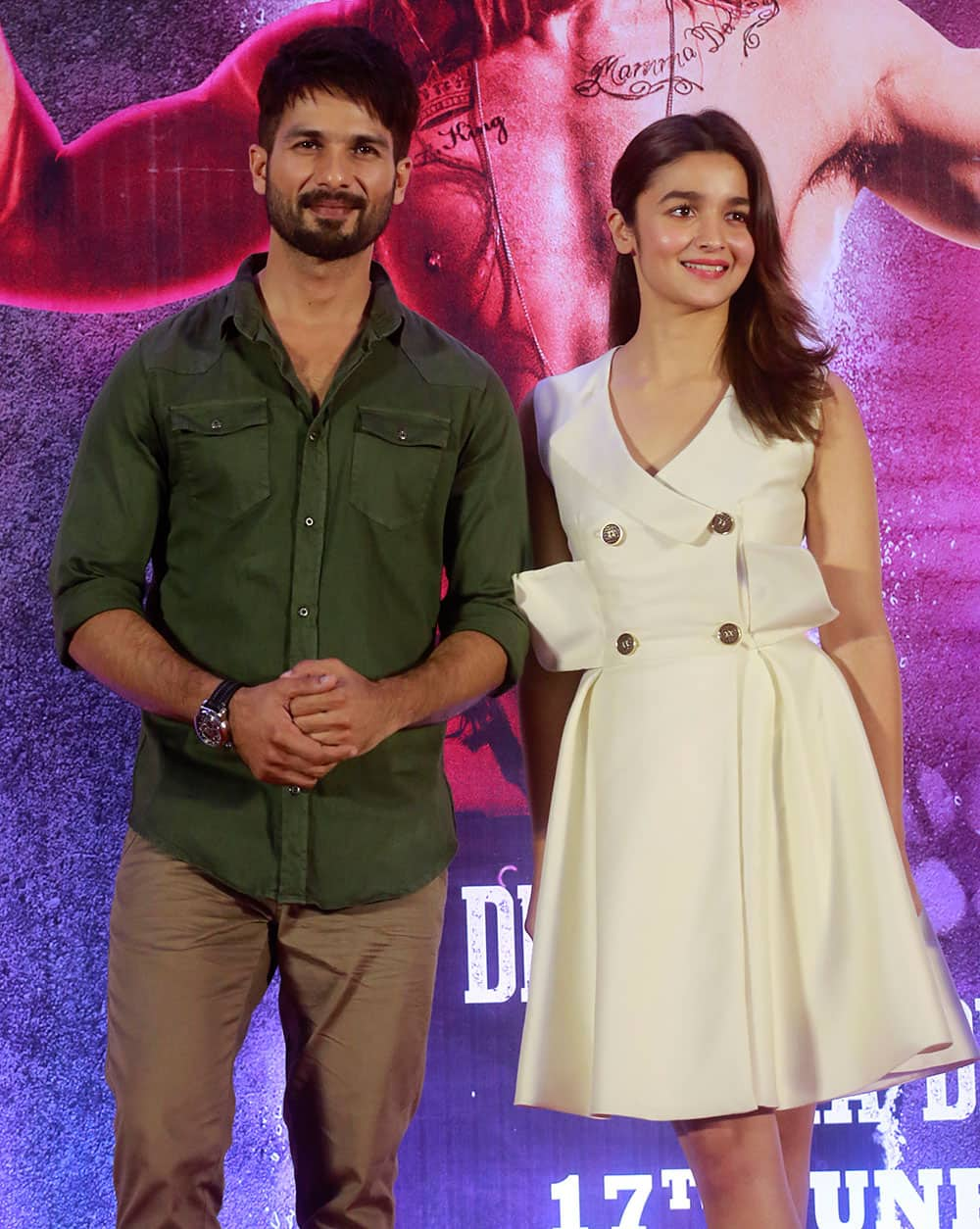 Shahid Kapoor and Alia Bhatt pose for photographs after a press conference of the film in Mumbai